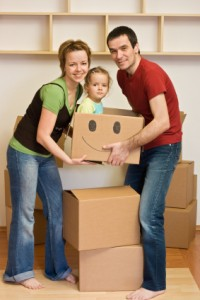Happy family with a kid moving into a new home